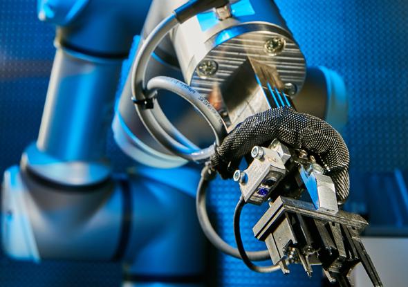 Blue Light sensor in a robot gripper - SensoPart